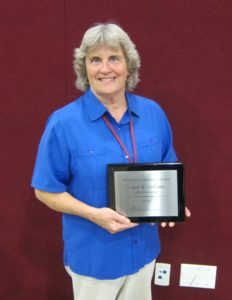 Carol Coburn with her Distinguished Historian Award