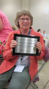 "Maggie McGuinness with her Distinguished Book Award for ""Called to Serve: A History of Nuns in America"""